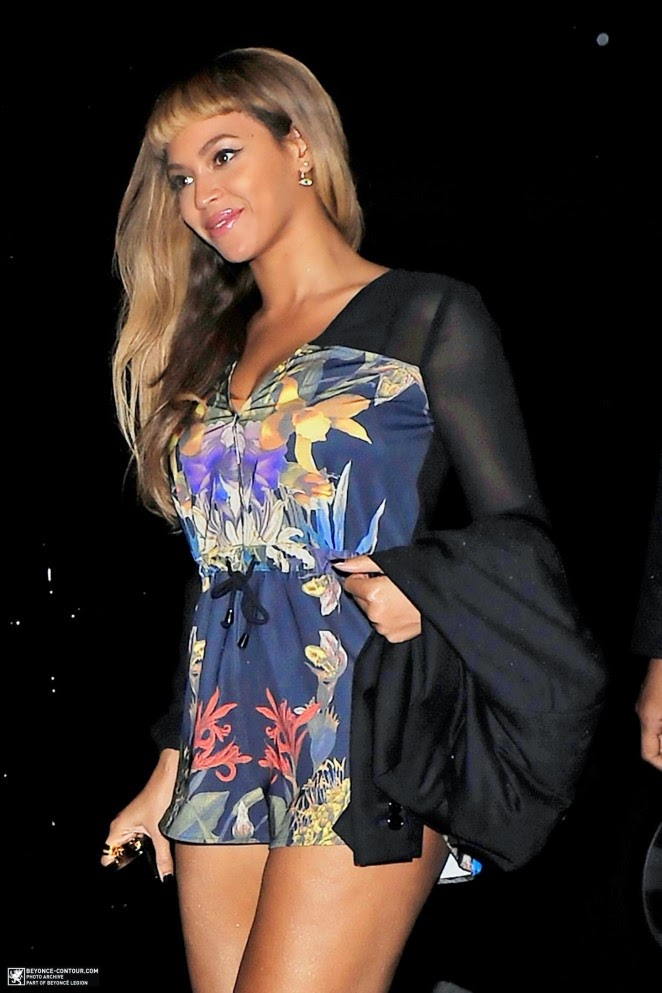 Beyonce spotted showing off long legs at Harry's Bar in London in a floral playsuit