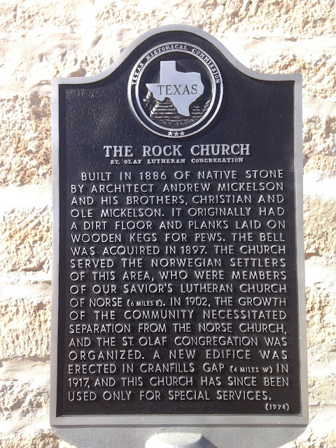 """Built in 1886 of the native stone by architect Andrew Mickelson and his brothers, Christian and Ole Mickelson. It originally had a dirt floor and planks laid on wooden kegs for pews. The bell was acquired in 1897. The church served the Norwegian settlers of this area, who were members of Our Savior's Lutheran Church of Norse (6 miles E). In 1902, th growth of the community necessitated separation from the Norse Church and the St. Olaf congregation was organized. A new ediface was erected in Cranfills Gap (4 miles W) in 1917, and the church has since been used only for special services."""