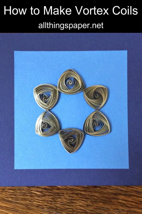 gilded vortex coil six-point star on a quilled card