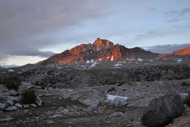 sharp red mountain with lots of crevases turned redder in the late light