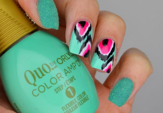 neon green ikat print nails holding nail polish bottle
