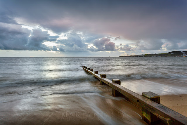 Groyne on Swanage seafront on the Dorset coast at sunrise
