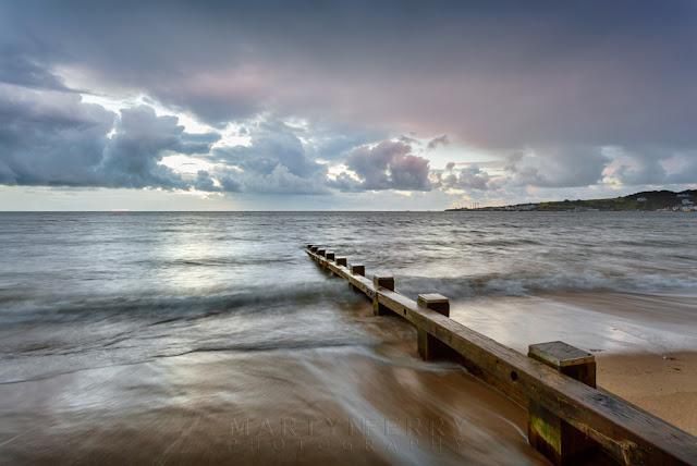 Groyne on Swanage seafront on the Dorset coast at sunrise