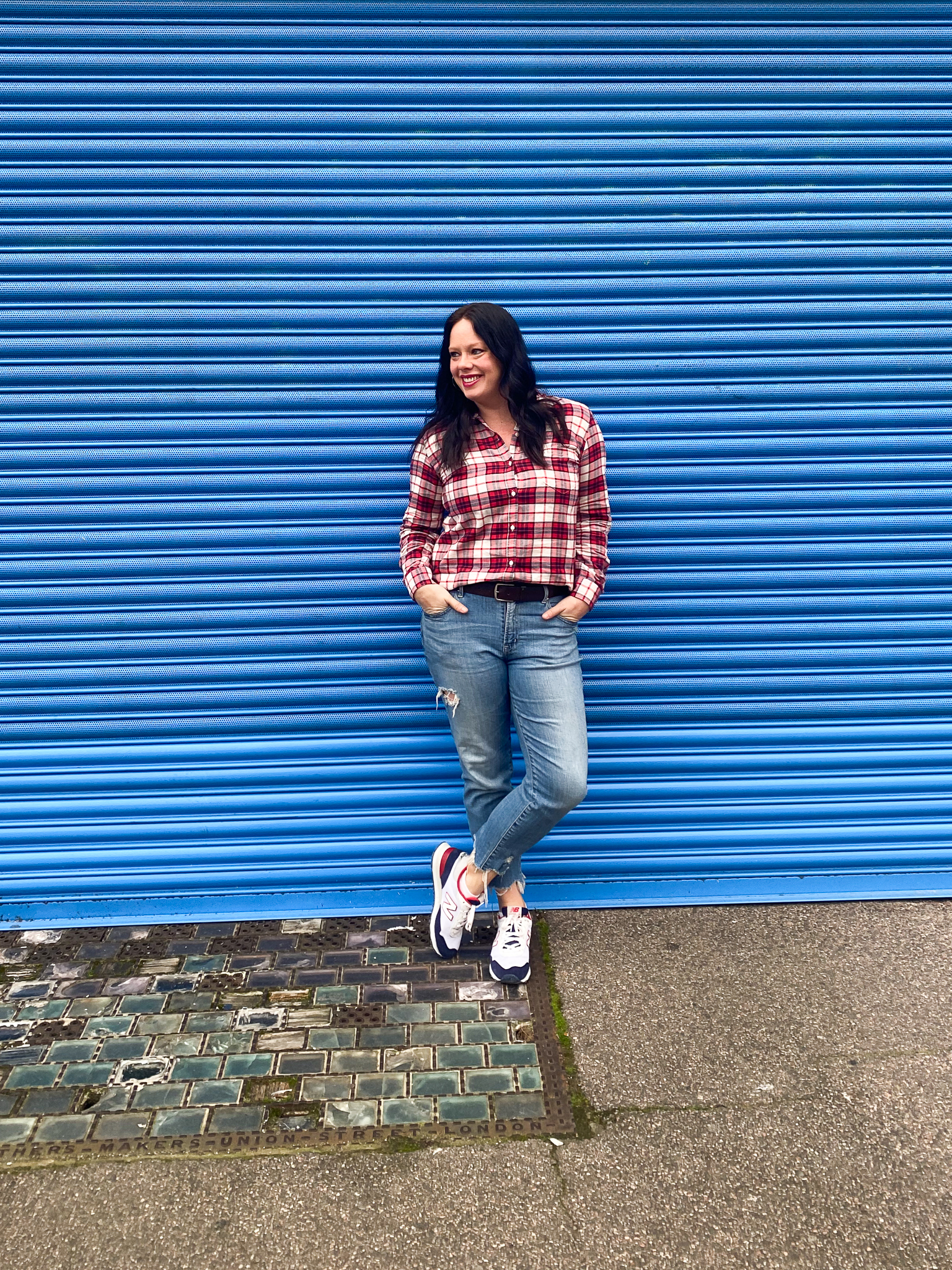 Red, white & blue plaid shirt with distressed jeans