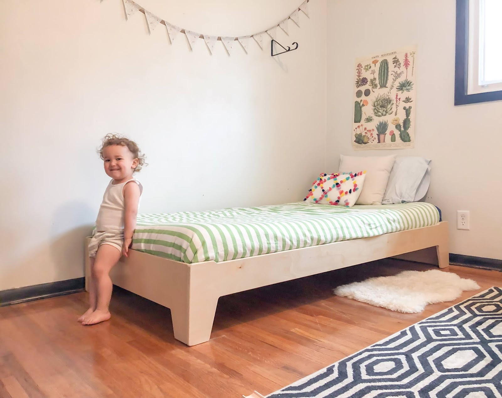 Thoughts on why your toddler may need a Montessori floor bed to promote freedom of movement and independence.