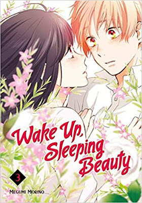 A high school boy and girl, her arms on his, leaning in close, surrounded by small flowers