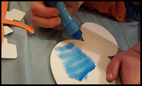 Little hands holding Little Brian Paint Sticks