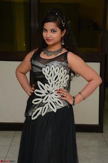 Shrisha Dasari in Sleeveless Short Black Dress At Follow Follow U Audio Launch 014.JPG