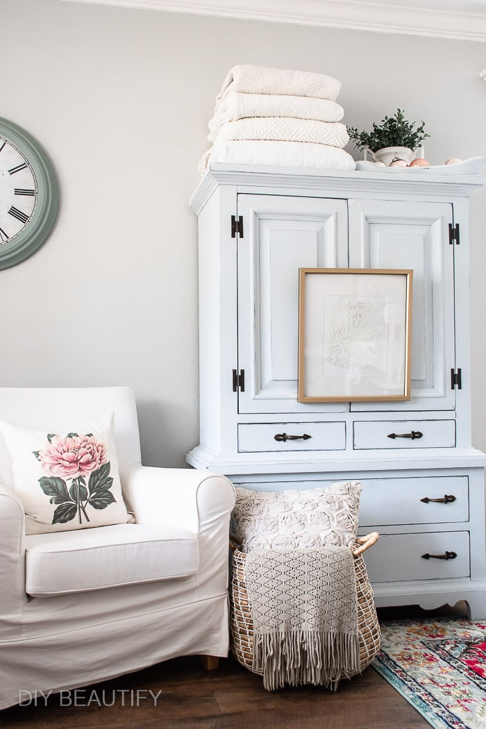 blue hutch and cozy armchair