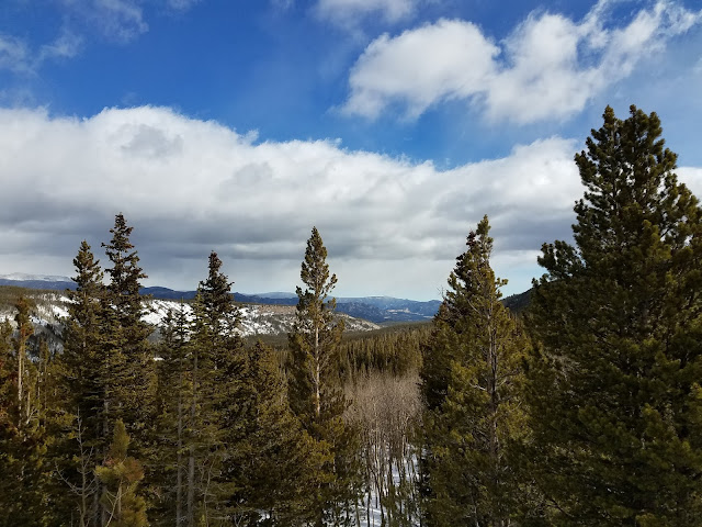 View of Rocky Mountain National Park with snow