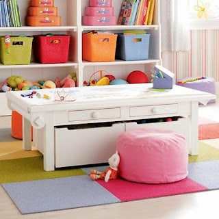 Bins under the play table are another way to save space and create storage