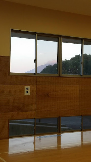 the volcano Sakurajima seen from inside the university dojo