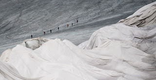 A portion of the Rhône Glacier in Switzerland is covered in blankets to help prevent it from melting. (Credit: Urs Flueeler/Keystone/Associated Press) Click to Enlarge.