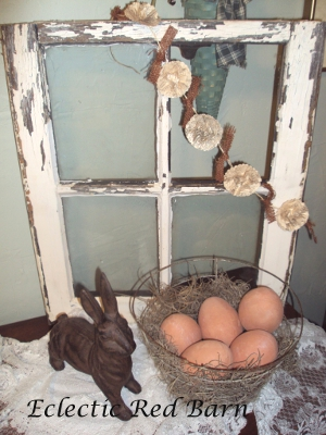 Eclectic Red Barn: Old, old window with cast iron bunny and wire basket