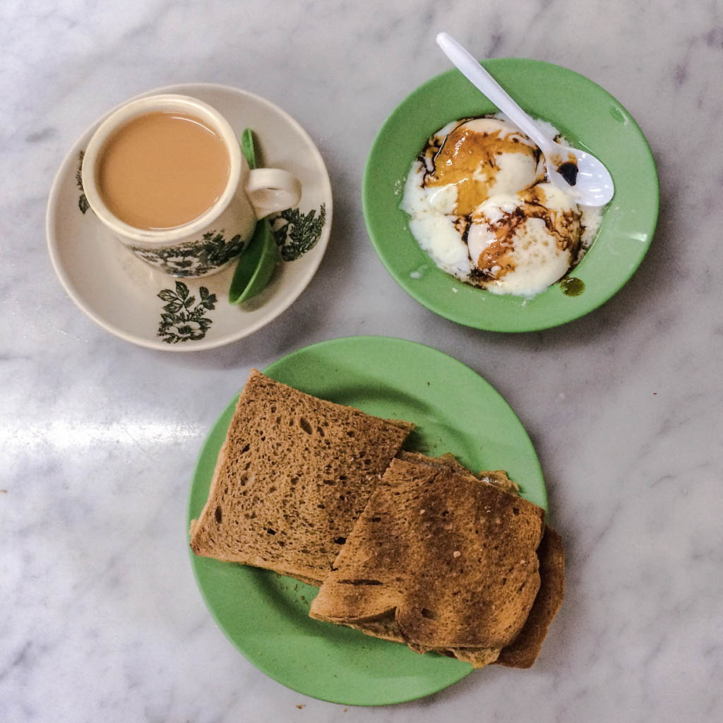 Kaya toast with poached eggs and sweet milk tea