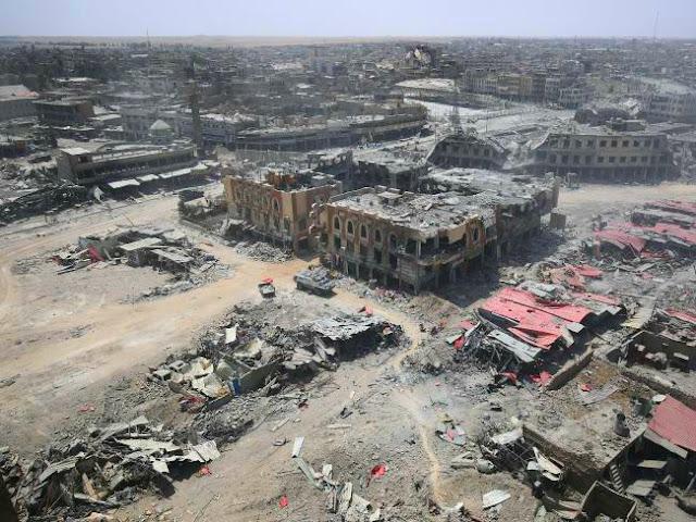 """IRAQI Prime Minister Haider al-Abadi has pronounced triumph in the """"freed"""" city of Mosul"""