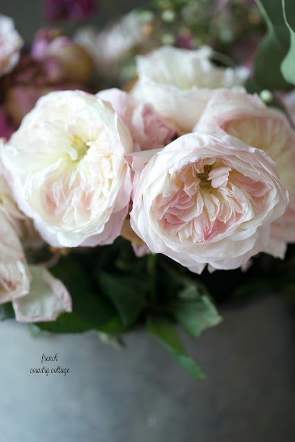 David Austin garden roses with ruffles in antique bucket