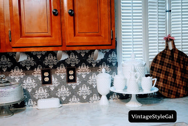 milk glass collection sitting on counter