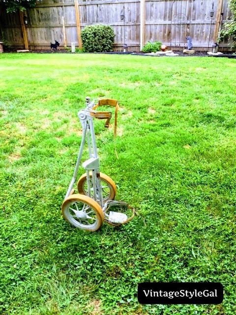 Old golf caddie in yard
