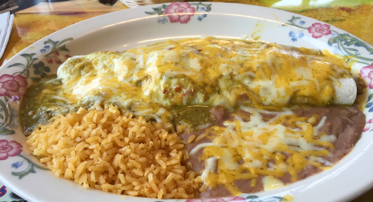 Smothered Chile Verde  Burrito with rice and beans