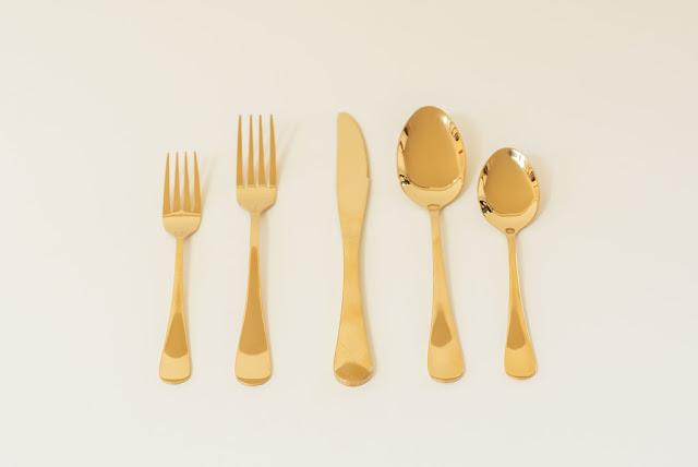 At Last Wedding + Event Design gold flatware rental