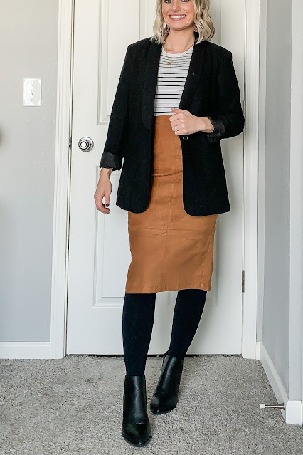 Faux suede skirt styled with striped crew neck shirt