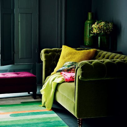 Dark Living room with Green velvet Couch Source: Redonline