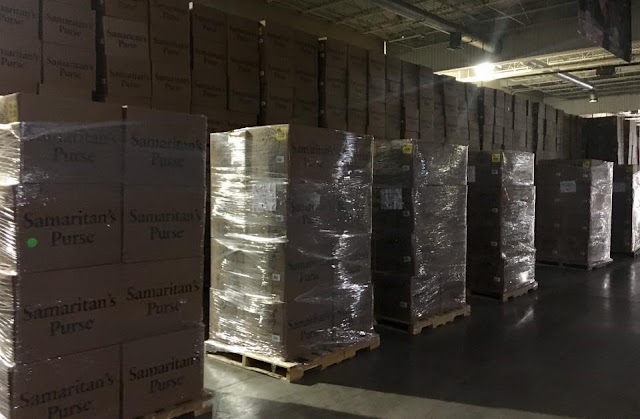 Operation Christmas Child processing center wrapped pallets of shoebox cartons