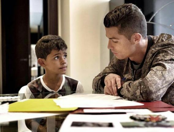 Daddy duties! Ronaldo helps out his son with school homework (Photo)