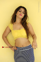 Cute Telugu Actress Shunaya Solanki High Definition Spicy Pos in Yellow Top and Skirt  0514.JPG