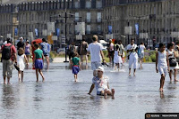 People cool off from the heat at the Miroir d'Eau (Mirror of Water), a public art piece on the quay of the Garonne River, during a warm summer day in Bordeaux, southwestern France, June 30, 2015. (Credit: Reuters/Regis Duvignau) Click to Enlarge.