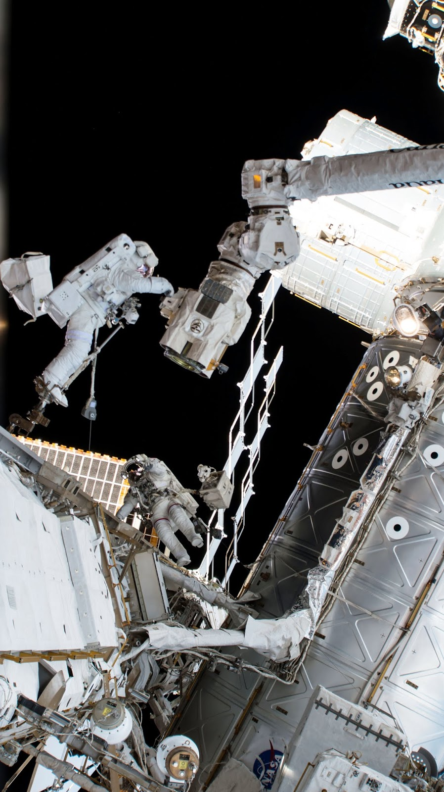 astronauts outside the Space Station in space