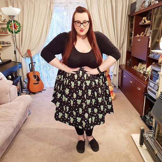 plus size girl wearing Hell Bunny Cactus Skirt