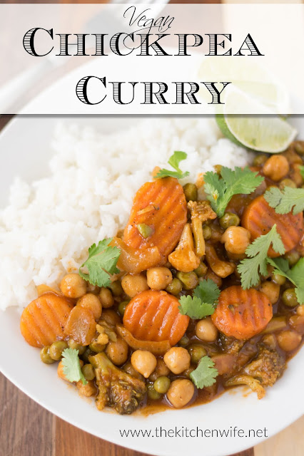The finished plate of Easy Vegan Chickpea Curry with some rice, lime, and the title above.
