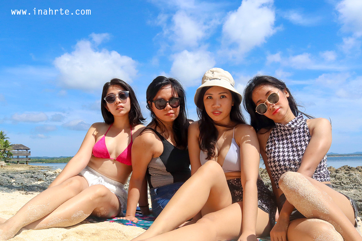 INAHRTE | four girls sitting by the beach
