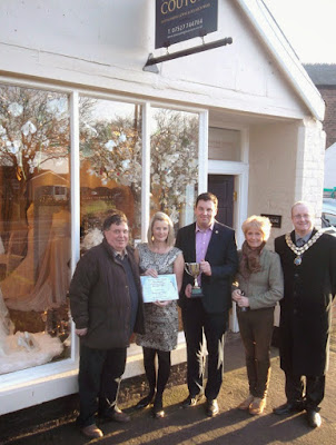 Picture: Joanna Leigh Couture of Brigg receiving the first prize trophy for having the best shop window from Brigg & Goole MP Andrew Percy in December  2014 - see Nigel Fisher's Brigg Blog