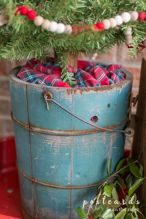 vintage turquoise wooden ice cream bucket with plaid fabric