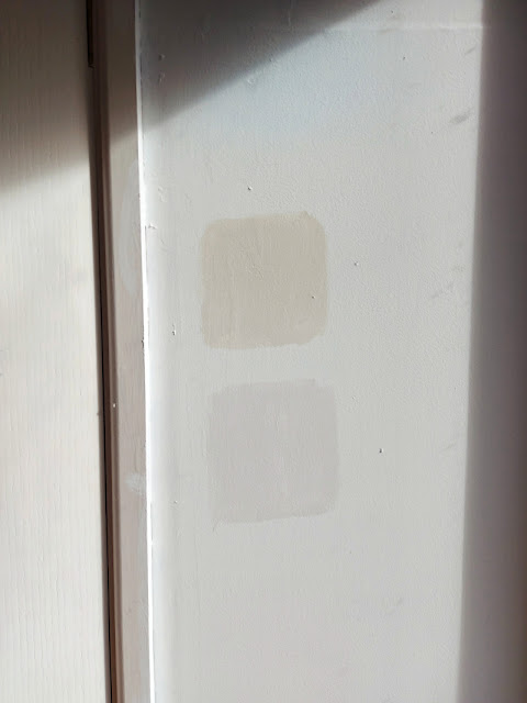 Two samples of off-white paint against a white background