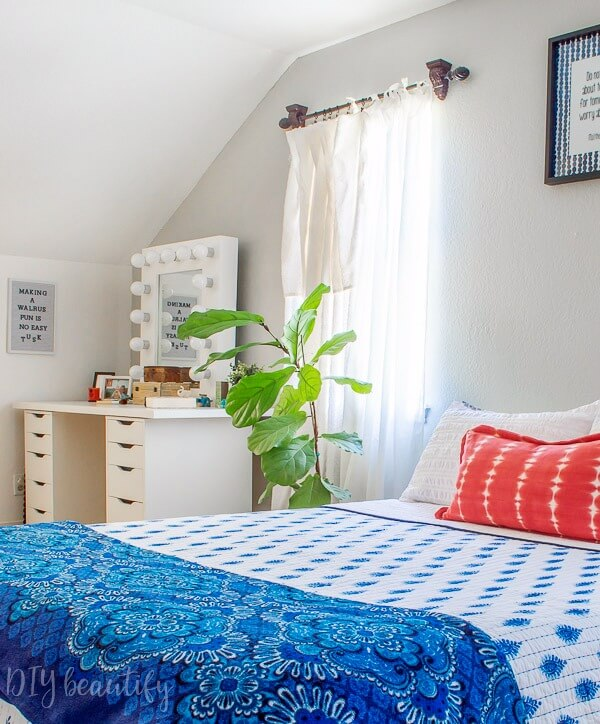 teen girl bedroom with platform bed, Hollywood mirror and teenage touches