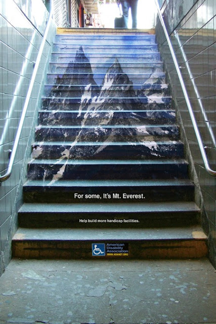 Photo of stairs with a picture of Mt Everest, depicting struggle of stairs for mobility impaired.
