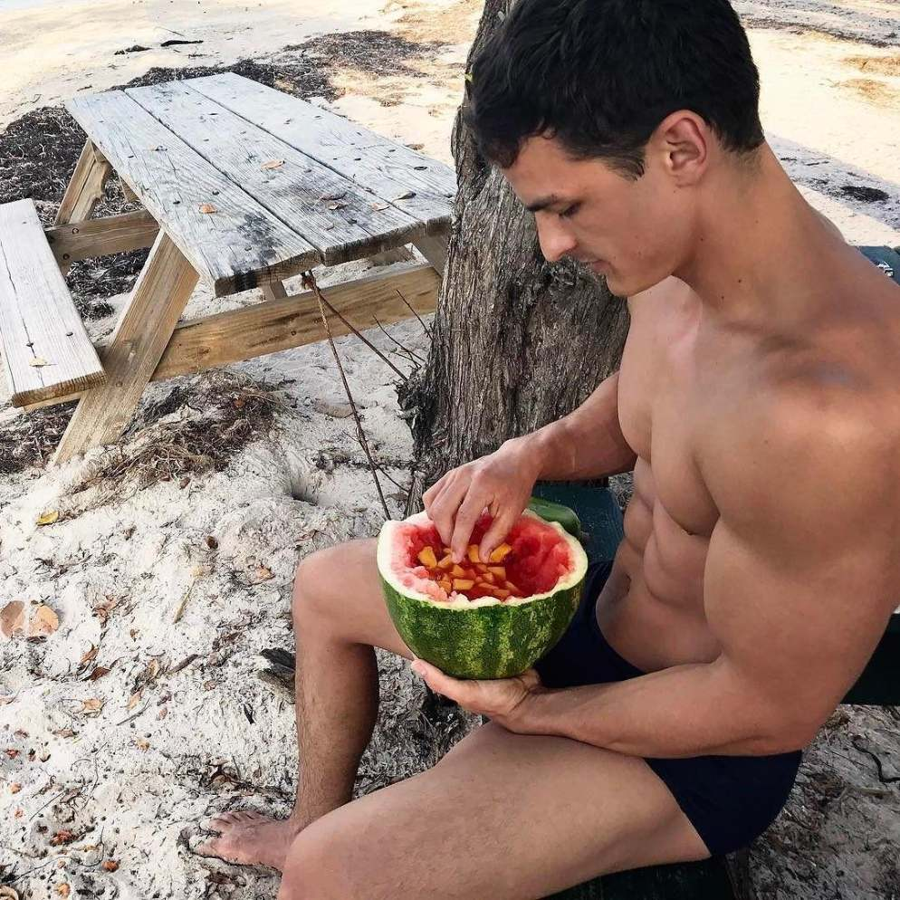 shirtless-fit-beach-bro-healthy-watermelon-fruity-drink-muscle-biceps-sixpack-abs