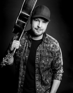 Picture of Gavin DeGraw carrying guitar