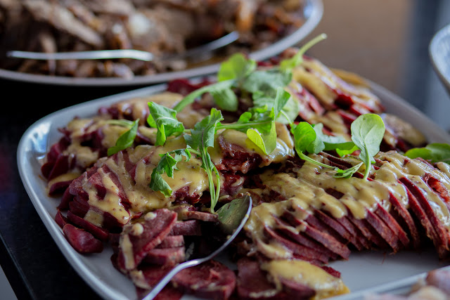 Smoked Beef Tongue with fresh Rocket Close-Up Photography