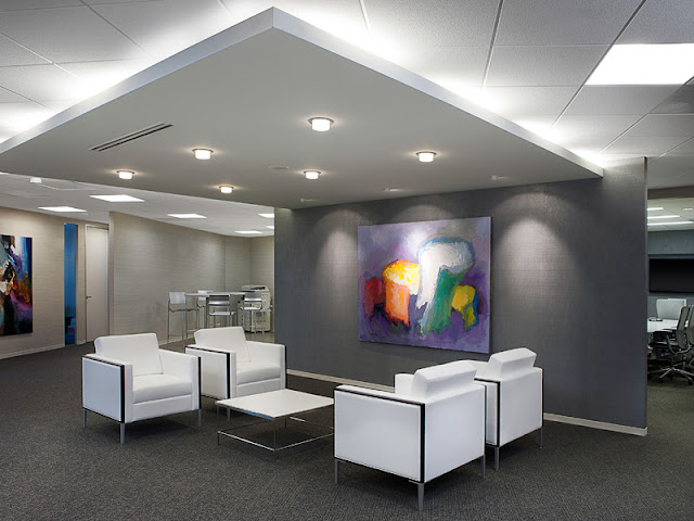 office waiting area with gray and white design