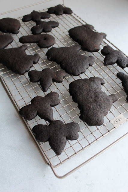 black chocolate cut out cookies cooling on wire rack