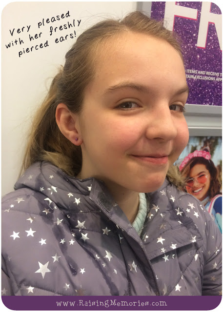 Happy girl with freshly pierced ears