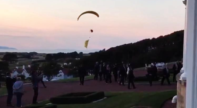 Protester paraglides over Trump, gets away