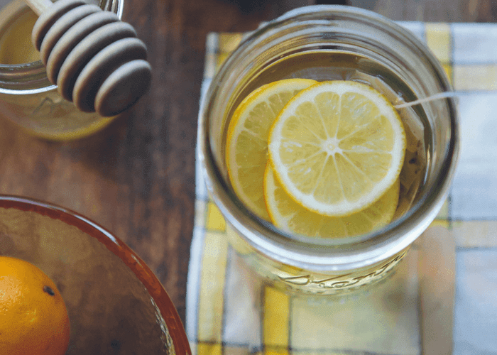 How to get relief from cough and cold with a honey lemon drink. This easy natural cough remedy works fast to stop coughing. Make with tea or water for night time. This is safe for kids over 1.  Make this homemade natural remedy for cough for sore throat or for a cold. Helps reduce mucous and hacking so you can get rest. #honey #lemon