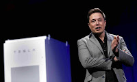 'We need to fight the propaganda of the fossil fuel industry,' says Elon Musk. (Photograph Credit: Patrick T Fallon/Reuters) Click to Enlarge.