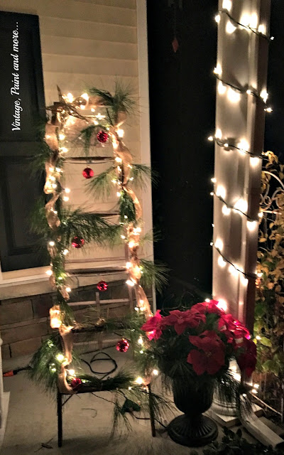 Christmas on the porch with thrifted and decorated ladder, wagon